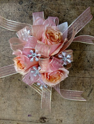 Coral roses corsage from Rose Garden Florist in Barnegat, NJ
